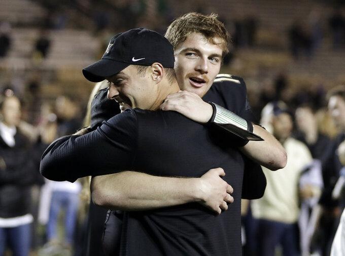 Vanderbilt quarterback Kyle Shurmur, right, gets a hug after the team defeated Tennessee in an NCAA college football game Saturday, Nov. 24, 2018, in Nashville, Tenn. (AP Photo/Mark Humphrey)