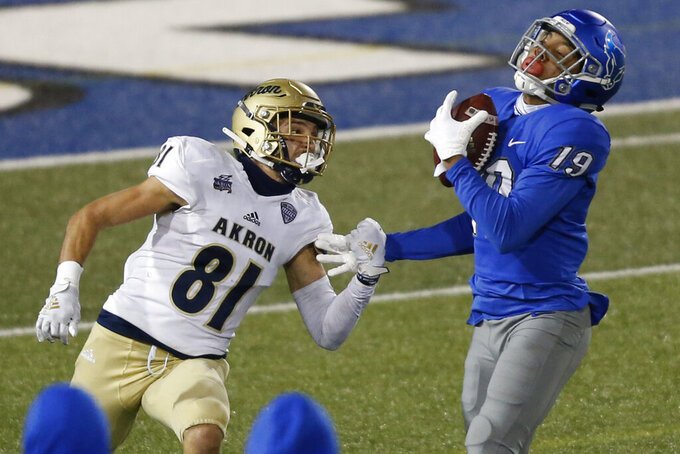 Buffalo's Shemar Hayes (19) steps in front of Akron receiver Shawn Naim (81) for an interception during the second half of an NCAA college football game in Amherst, N.Y., Saturday, Dec. 12, 2020. (AP Photo/Jeffrey T. Barnes)