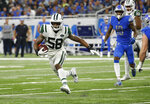 New York Jets linebacker Darron Lee (58) runs after an interception during the second half of an NFL football game against the Detroit Lions in Detroit, Monday, Sept. 10, 2018. (AP Photo/Rick Osentoski)