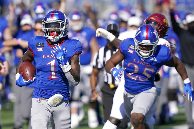 Kansas return specialist Kenny Logan Jr. (1) returns a kickoff 100-yards for a touchdown during the second half of an NCAA college football game against Iowa State in Lawrence, Kan., Saturday, Oct. 31, 2020. (AP Photo/Orlin Wagner)