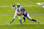 Carolina Panthers quarterback Teddy Bridgewater (5) tries to break a tackle by Minnesota Vikings defensive end D.J. Wonnum, right, during the first half of an NFL football game, Sunday, Nov. 29, 2020, in Minneapolis. (AP Photo/Charlie Neibergall)