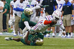 Florida quarterback Emory Jones (5) dives for yardage getting by South Florida defensive back Daquan Evans (0) and defensive back Jayden Curry (15) during the second half of an NCAA college football game Saturday, Sept. 11, 2021, in Tampa, Fla. (AP Photo/Chris O'Meara)