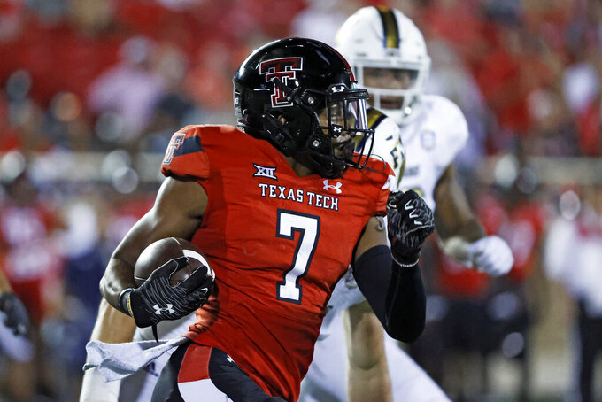 Texas Tech's Donovan Smith (7) runs with the ball during the second half of an NCAA college football game against Florida International, Saturday, Sept. 18, 2021, in Lubbock, Texas. (AP Photo/Brad Tollefson)