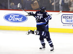 Winnipeg Jets' Mathieu Perreault (85) and Mark Scheifele (55) celebrate after Scheifele scored against the Washington Capitals with 15 seconds left during the third period of an NHL hockey game Tuesday, Feb. 13, 2018, in Winnipeg, Manitoba. (Trevor Hagan/The Canadian Press via AP)