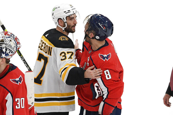 Boston Bruins center Patrice Bergeron (37) and Washington Capitals left wing Alex Ovechkin (8) meet in the handshake line after Game 5 of an NHL hockey Stanley Cup first-round playoff series, Sunday, May 23, 2021, in Washington. The Bruins won 3-1. (AP Photo/Nick Wass)