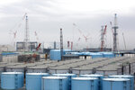 FILE - In this Feb. 23, 2017, file photo, storage tanks for contaminated water stand at the Fukushima Dai-ichi nuclear power plant of the Tokyo Electric Power Company (TEPCO) in Okuma town, Fukushima prefecture, northeastern Japan. The head of the wrecked Fukushima nuclear plant said Tuesday, March 2, 2021 there's no need to extend the current target to finish its decommissioning in 30-40 years despite uncertainties about melted fuel inside the plant's three reactors. (Tomohiro Ohsumi/Pool Photo via AP, File)