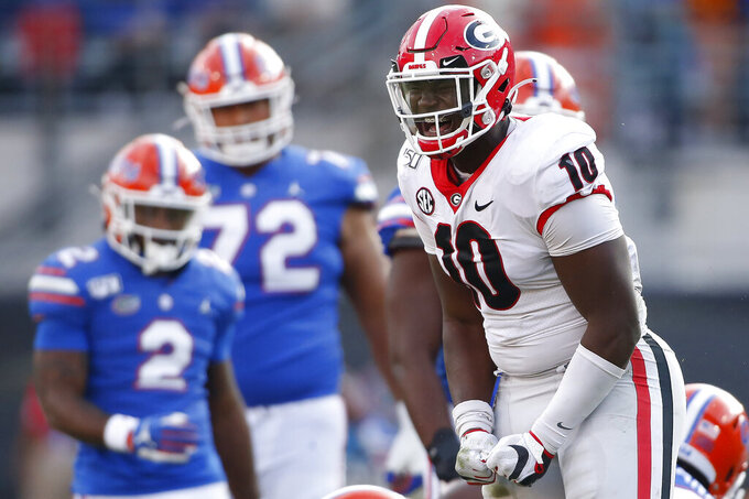 Georgia defensive lineman Malik Herring (10) celebrates after sacking Florida quarterback Kyle Trask (11) in the second half of an NCAA college football game Saturday, Nov. 2, 2019, in Jacksonville, Fla. Georgia won 24-17.  (Joshua L. Jones/Athens Banner-Herald via AP)