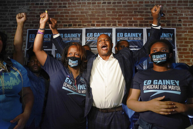 State Rep. Ed Gainey celebrates with wife Michelle, left, after winning the Democratic primary for Pittsburgh mayor, Tuesday, May 18, 2021, in Pittsburgh. (Steve Mellon/Pittsburgh Post-Gazette via AP)