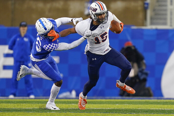 UT Martin tight end Colton Dowell (15) runs with the ball during the first half of an NCAA college football game against Kentucky, Saturday, Nov. 23, 2019, in Lexington, Ky. (AP Photo/Bryan Woolston)