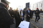 "Muslim religious leaders are guided during a visit to the former Nazi death camp of Auschwitz, in what organizers called ""the most senior Islamic leadership delegation"