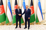 """In this handout photo released by Uzbekistan's President Shavkat Mirziyoyev's Press service, Uzbekistan's President Shavkat Mirziyoyev, right, and Afghanistan's President Ashraf Ghani pose for a photo prior to their talks in Tashkent, Uzbekistan, Thursday, July 15, 2021. The two leaders reaffirmed that there is no military solution to the conflict in Afghanistan and spoke for a quick resumption of the inclusive inter-Afghan talks,"""" Mirziyoyev's office said in a statemen, adding that the Uzbek president emphasized his country's readiness to help achieve a stable peace in Afghanistan. (Uzbekistan's President Shavkat Mirziyoyev's Press service via AP)"""