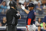 Boston Red Sox's Rafael Devers argues with home plate umpire Manny Gonzalez during the sixth inning of the team's baseball game against the New York Yankees on Sunday, July 18, 2021, in New York. (AP Photo/Adam Hunger)