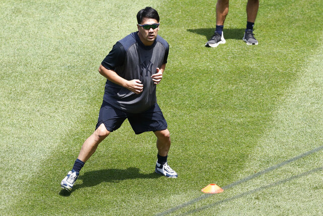 New York Yankees starting pitcher Masahiro Tanaka runs through drills at the Yankees summer baseball training camp, Wednesday, July 15, 2020, at Yankee Stadium in New York. Tanaka was hit in the head by Giancarlo Stanton's line drive July 4th and suffered a mild concussion, but says he is progressing and feels lucky. (AP Photo/Kathy Willens)