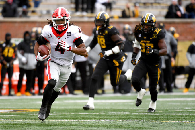 Georgia running back James Cook heads for the end zone after catching a 37-yard pass for a touchdown during the first half of an NCAA college football game against Missouri Saturday, Dec. 12, 2020, in Columbia, Mo. (AP Photo/L.G. Patterson)