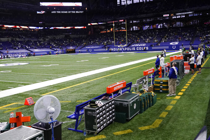 The Green Bay Packers sideline is empty during the national anthem before an NFL football game against the Indianapolis Colts, Sunday, Nov. 22, 2020, in Indianapolis. (AP Photo/AJ Mast)