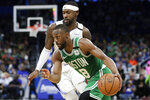 Boston Celtics guard Kemba Walker (8) drives to the basket past Orlando Magic guard Terrence Ross during the second half of an NBA basketball game, Friday, Jan. 24, 2020, in Orlando, Fla. (AP Photo/John Raoux)