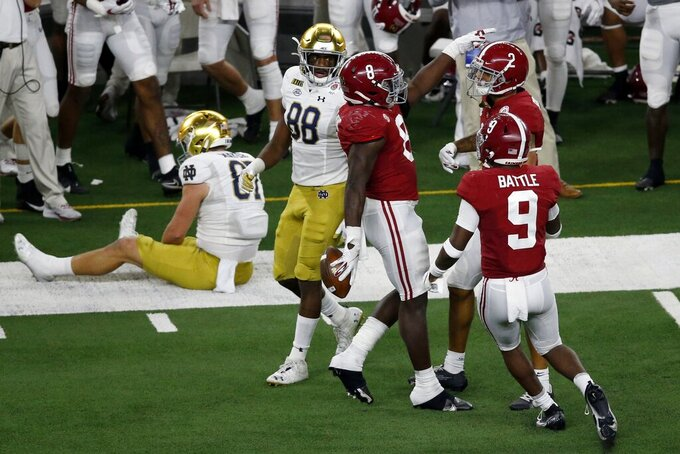 Alabama linebacker Christian Harris (8), defensive back Jordan Battle (9) and defensive back Patrick Surtain II (2) celebrate an interception by Harris on a pass intended for Notre Dame tight end Michael Mayer (87) as wide receiver Javon McKinley (88) looks on in the second half of the Rose Bowl NCAA college football game in Arlington, Texas, Friday, Jan. 1, 2021. (AP Photo/Roger Steinman)