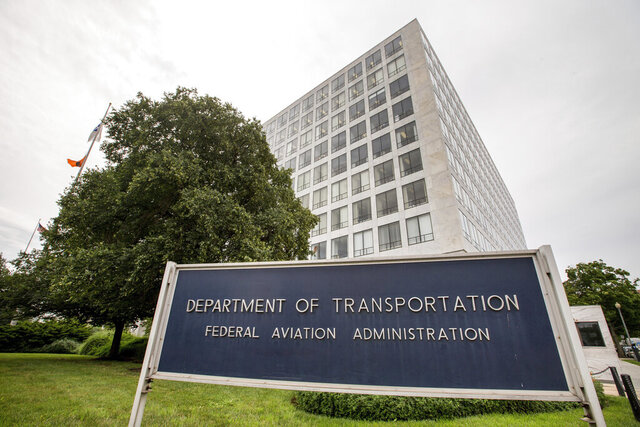 FILE - This June 19, 2015, file photo, shows the Department of Transportation Federal Aviation Administration building in Washington. Federal employees overseeing Boeing and other aircraft makers say they face pressure from the companies and fear retribution from their own bosses if they raise too many safety concerns, according to a survey of the workers that was delivered to Congress on Friday, Aug. 7, 2020. (AP Photo/Andrew Harnik, File)