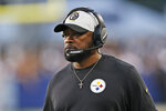 Pittsburgh Steelers coach Mike Tomlin watches during the first half of the team's Pro Football Hall of Fame NFL preseason game against the Dallas Cowboys, Thursday, Aug. 5, 2021, in Canton, Ohio. (AP Photo/Ron Schwane)