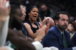 Boston Celtics assistant coach Kara Lawson applauds after a 3-point shot by Jaylen Brown during the second half of an NBA basketball game against the Miami Heat in Boston, Wednesday, Dec. 4, 2019. (AP Photo/Charles Krupa)