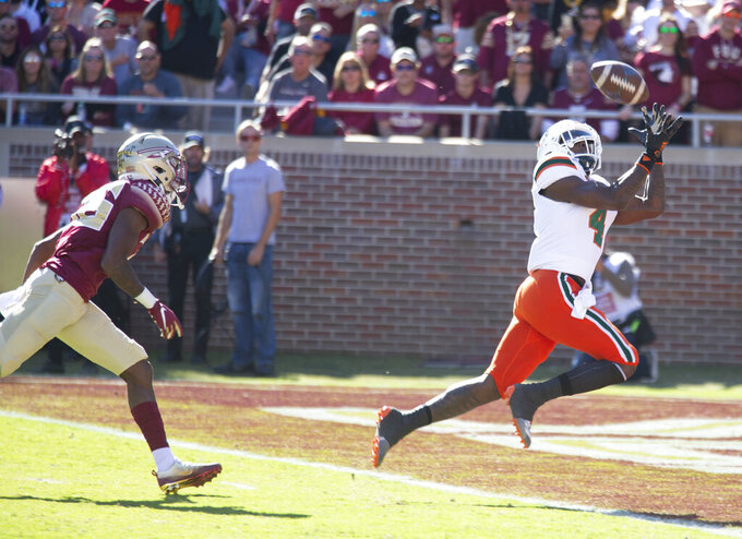 Miami wide receiver Jeff Thomas (4) gets ahead of Florida State defensive back Renardo Green (36) for a 39-yard touchdown in the first half of an NCAA college football game in Tallahassee, Fla., Saturday, Nov. 2, 2019. (AP Photo/Mark Wallheiser)