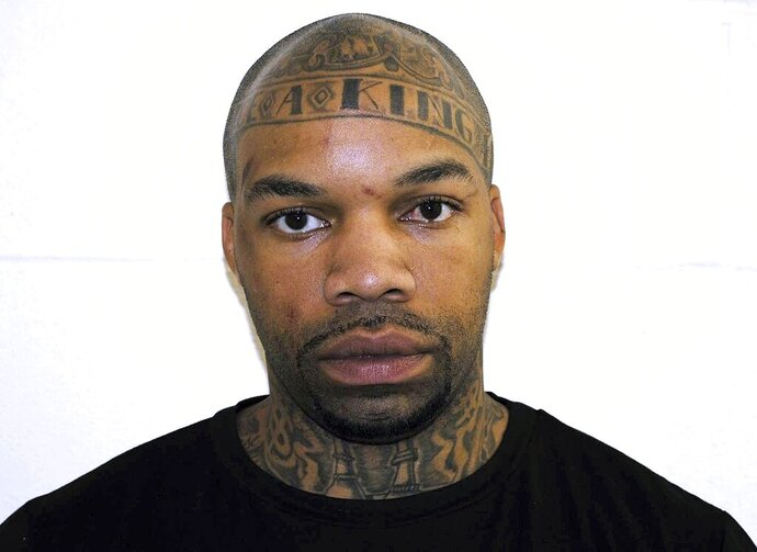 FILE - This undatd booking photo released by the Pelham Police Department shows Dale Holloway. The family of a bishop who was shot in the chest while presiding at a church wedding in New Hampshire wedding says he's still recovering from multiple gunshot wounds and remains in critical condition.  Holloway, of Manchester, faces charges of attempted murder and assault stemming from the shooting, which also injured bride Claire McMullen. He's pleaded not guilty.  (Pelham Police Department via AP, File)