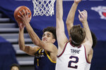 Northern Arizona guard Jay Green (1) shoots next to Gonzaga forward Drew Timme (2) during the first half of an NCAA college basketball game in Spokane, Wash., Monday, Dec. 28, 2020. (AP Photo/Young Kwak)