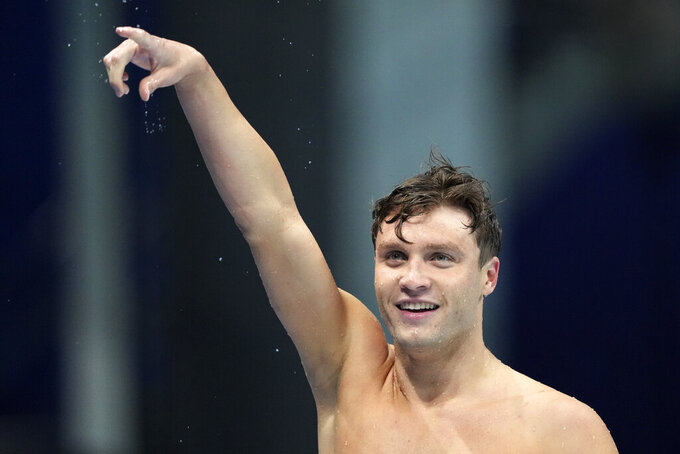 Robert Finke of the United States celebrates winning the men's 800-meters freestyle final at the 2020 Summer Olympics, Thursday, July 29, 2021, in Tokyo, Japan. (AP Photo/Matthias Schrader)