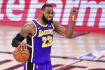 Los Angeles Lakers' LeBron James directs a play against the Denver Nuggets during the second half of an NBA conference final playoff basketball game Saturday, Sept. 26, 2020, in Lake Buena Vista, Fla. (AP Photo/Mark J. Terrill)