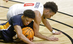 Toledo guard Ryan Rollins and Richmond guard Jacob Gilyard (0) go to the floor for a loose ball during the first half of an NCAA college basketball game in the first round of the NIT, Wednesday, March 17, 2021, in Denton, Texas. (AP Photo/Ron Jenkins)