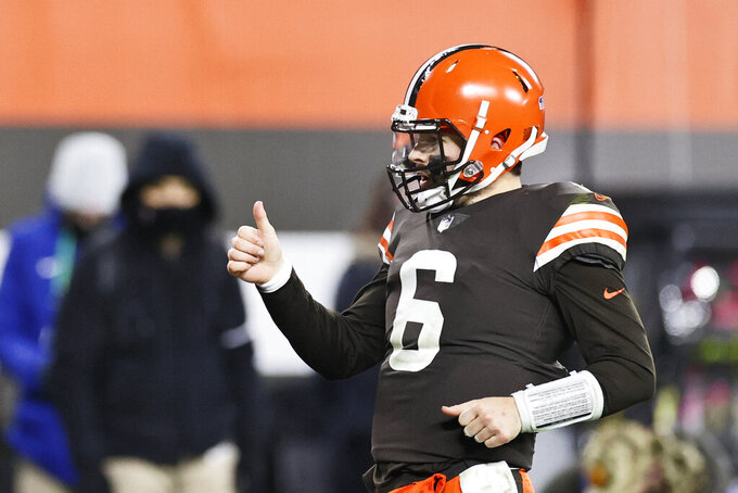 Cleveland Browns quarterback Baker Mayfield celebrates a 21-yard touchdown pass to wide receiver Rashard Higgins during the second half of an NFL football game against the Baltimore Ravens, Monday, Dec. 14, 2020, in Cleveland. (AP Photo/Ron Schwane)