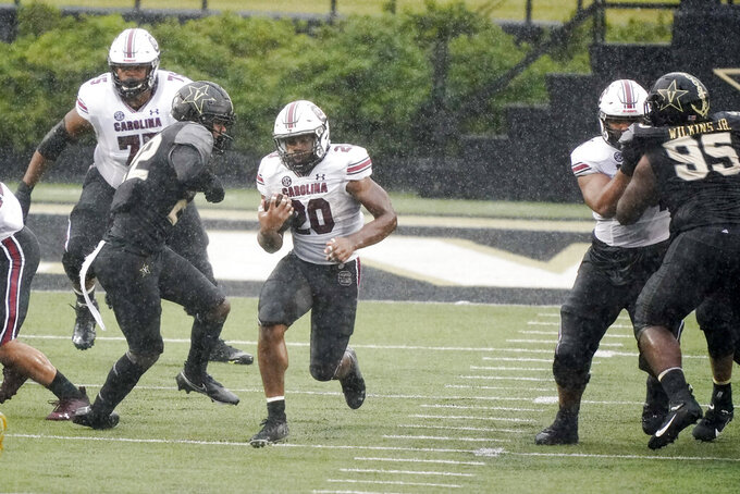 South Carolina running back Kevin Harris (20) breaks past Vanderbilt defenders as he runs 88 yards for a touchdown in the second half of an NCAA college football game Saturday, Oct. 10, 2020, in Nashville, Tenn. South Carolina won 41-7. (AP Photo/Mark Humphrey)