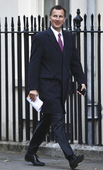 Britain's Foreign Secretary Jeremy Hunt arrives for a cabinet meeting in Downing Street, London, Tuesday March 5, 2019. European Union and British top-level officials will resume talks on Tuesday in an attempt to break a deadlock in the Brexit negotiations less than a month before the United Kingdom is scheduled to leave the bloc. (Stefan Rousseau/PA via AP)