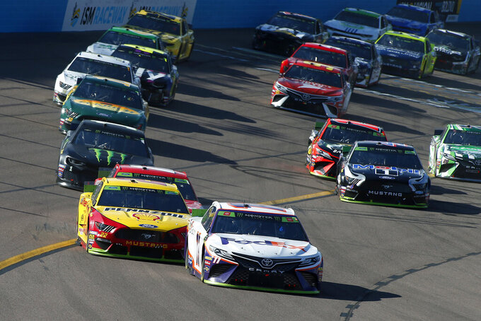 Denny Hamlin (11) leads the field during the NASCAR Cup Series auto race at ISM Raceway, Sunday, Nov. 10, 2019, in Avondale, Ariz. (AP Photo/Ralph Freso)