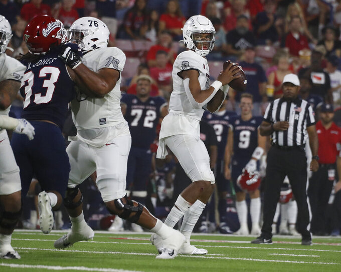 UNLV quarterback Doug Brumfield drops back to pass against Fresno State during the first half of an NCAA college football game in Fresno, Calif., Friday, Sept. 24, 2021. (AP Photo/Gary Kazanjian)