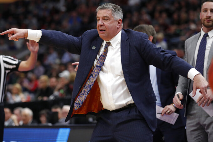 Auburn head coach Bruce Pearl directs his team in the first half against New Mexico State during a first round men's college basketball game in the NCAA Tournament Thursday, March 21, 2019, in Salt Lake City. (AP Photo/Jeff Swinger)