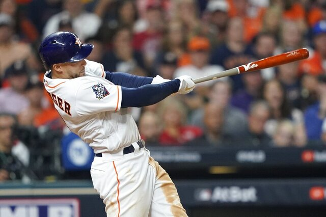 FILE - In this Oct. 22, 2019, file photo, Houston Astros' George Springer hits a home run during the seventh inning of Game 1 of the baseball World Series against the Washington Nationals in Houston.  Springer asked for a raise from $12.15 million to $22.5 million and was offered $17.5 million in the biggest gap. (AP Photo/David J. Phillip, File)
