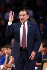 Duke head coach Mike Krzyzewski singles to his team on the floor in the first half of an NCAA college basketball game against Georgia Tech Wednesday, Jan. 8, 2020, in Atlanta. (AP Photo/John Bazemore)