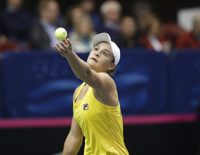 Australia's Ashleigh Barty serves during the first-round Fed Cup tennis match against United States' Madison Keys in Asheville, N.C., Sunday, Feb. 10, 2019. (AP Photo/Chuck Burton)