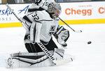 Los Angeles Kings goaltender Jonathan Quick blocks a shot by the San Jose Sharks during the third period of an NHL hockey game Saturday, April 10, 2021, in San Jose, Calif. Los Angeles won 4-2. (AP Photo/Tony Avelar)