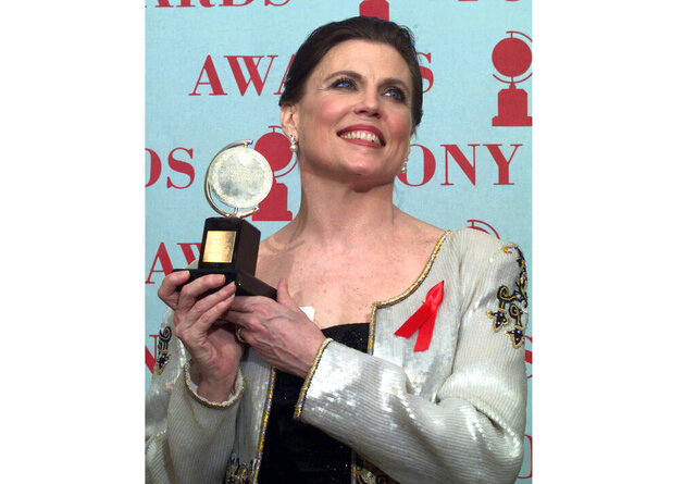 FILE - Ann Reinking holds her Tony Award for best choreography for the musical