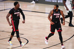 Miami Heat's Bam Adebayo (13) reacts to a basket along with teammate Andre Iguodala (28) during the second half of an NBA conference final playoff basketball game Sunday, Sept. 27, 2020, in Lake Buena Vista, Fla. (AP Photo/Mark J. Terrill)