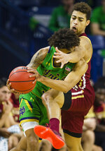 Notre Dame's Prentiss Hubb (3) tries to get past Boston College's Derryck Thornton (11) during an NCAA college basketball game Saturday, Dec. 7, 2019 at Purcell Pavilion in South Bend, Ind. (Michael Caterina/South Bend Tribune via AP)