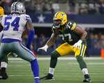 """FILE - In this Sunday, Oct. 6, 2019 file photo, Dallas Cowboys middle linebacker Jaylon Smith (54) lines up against Green Bay Packers offensive tackle Billy Turner (77) during an NFL football game in Arlington, Texas. Green Bay Packers right guard William """"Billy"""" Turner's perspective on life was bleak and negative after he was cut by the Dolphins in October 2016. But more than three years later, Turner's outlook has changed, and the 6-foot-5, 310-pound guard's conscious mission to spread positive energy has become a driving force behind the Packers' success this season. (AP Photo/Michael Ainsworth, File)"""
