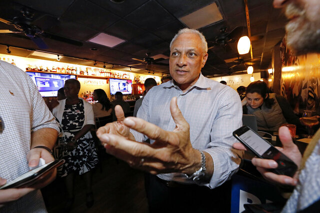 Mike Espy speaks to reporters, in Jackson, Miss., prior to winning the Democratic nomination for a U.S. Senate seat in Mississippi, Tuesday, March 10, 2020. After his victory Tuesday, he will face Republican incumbent U.S. Sen. Cindy Hyde-Smith and Libertarian candidate Jimmy Edwards in November. (AP Photo/Rogelio V. Solis)