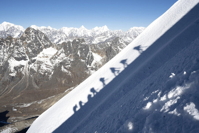 "This image released by National Geographic shows members of the National Geographic and Rolex Perpetual Planet Everest Expedition ascending a slope on Lobuche as part of their acclimatization before making their way toward Everest's summit in ""Expedition Everest,"