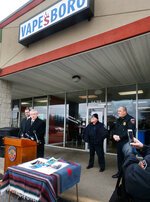 In this Feb. 12, 2018 photo, Rutherford County Sheriff Mike Fitzhugh speaks during a news conference in front of Vapesboro, one of 23 stores closed for selling products believed to contain a marijuana derivative, in Murfreesboro, Tenn. Vapesboro owners Scott and Gina Ritter, along with other shop owners, were arrested and falsely accused of selling drugs. Charges were eventually dropped, but they and other store owners filed a federal lawsuit against local agencies. (Helen Comer/The Daily News Journal via AP)