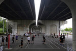 People gather to play basketball at a park Wednesday, June 3, 2020, in Yokohama, Japan. A coronavirus state of emergency was lifted, ending the restrictions nationwide as businesses began to reopen. (AP Photo/Kiichiro Sato)