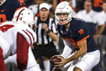 Illinois quarterback Brandon Peters (18) takes the snap in the first half of an NCAA college football game against Nebraska, Saturday, Sept. 21, 2019, in Champaign, Ill. (AP Photo/Holly Hart)