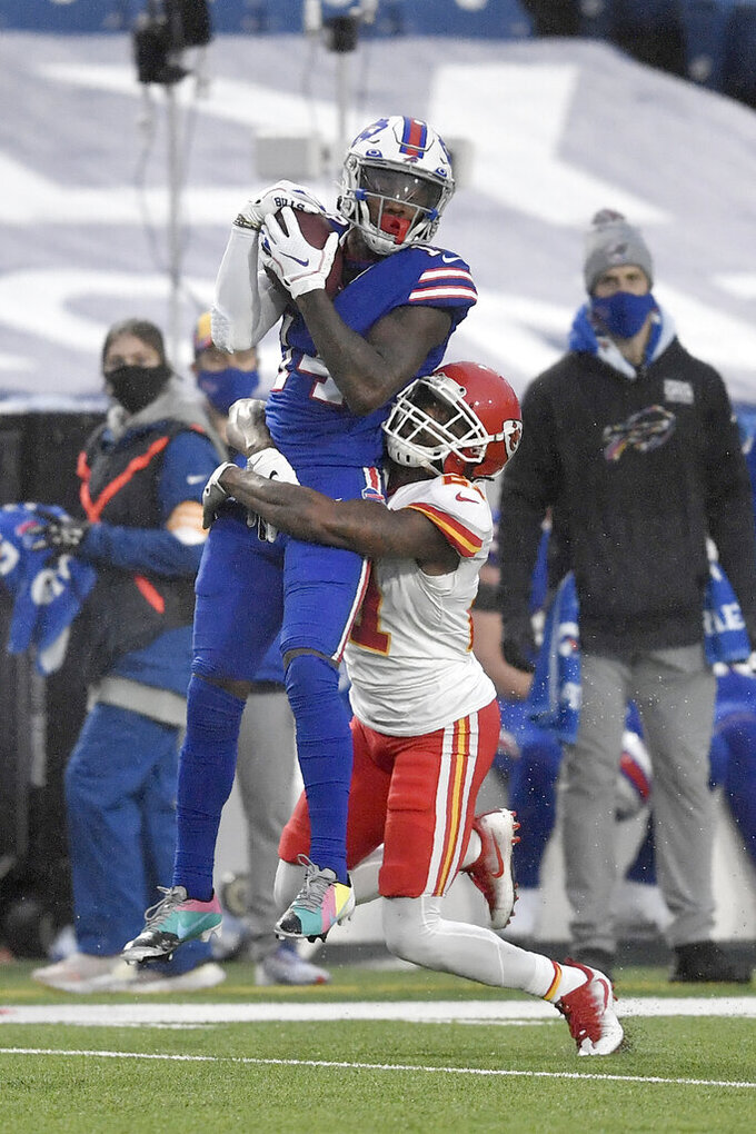 Buffalo Bills' Stefon Diggs, top, makes a catch as Kansas City Chiefs' Bashaud Breeland defends during the first half of an NFL football game, Monday, Oct. 19, 2020, in Orchard Park, N.Y. (AP Photo/Adrian Kraus)